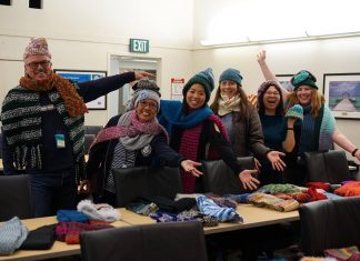 Chevron employees knit 260 scarves, socks and hats for charity
