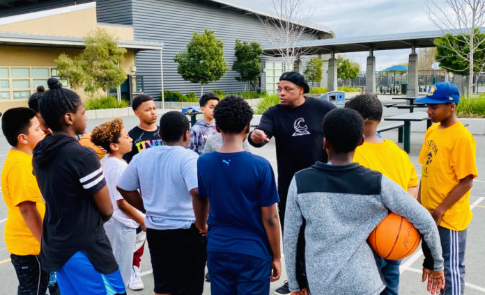 Coach Carter dishes assist to Richmond elementary school team