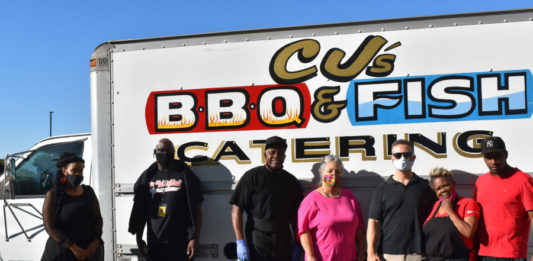 Homeless at Hilltop hotel served barbecue feast by community members