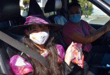 Candy-drive thru serves hundreds of costumed kids in Richmond
