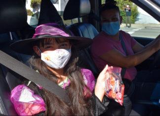 Candy-drive thru serves hundreds of costumed kids in Richmond