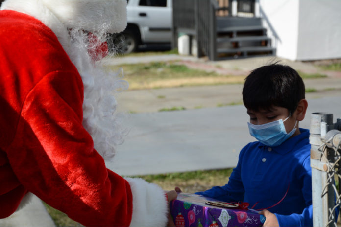 WCCUSD Santas deliver gifts to homes of Downer Elementary kindergarteners