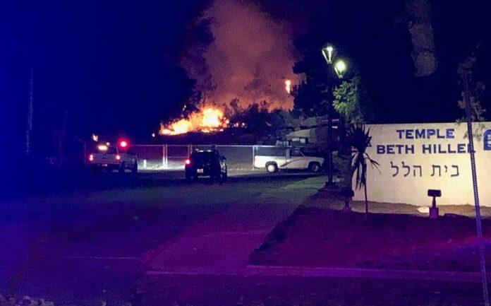 Vegetation fire burns 2 acres near Hilltop Drive